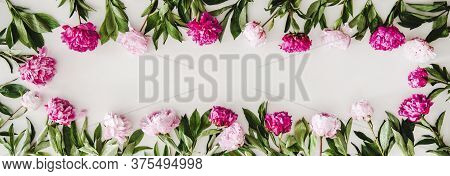 Summer Peonies Flowers Layout On Plain White Background, Copy Space