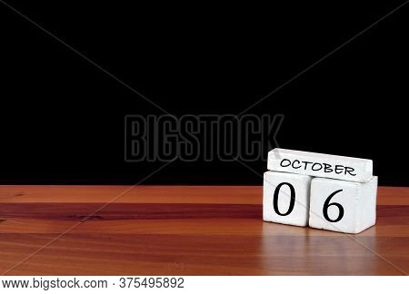 6 October Calendar Month. 6 Days Of The Month. Reflected Calendar On Wooden Floor With Black Backgro