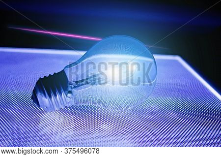Shining Light Bulb And Above It Pink Neon Line Luminous.black Luminous Mesh Is Reflected In The Bulb