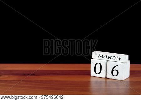 6 March Calendar Month. 6 Days Of The Month. Reflected Calendar On Wooden Floor With Black Backgroun