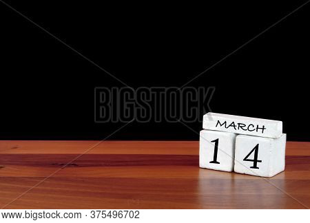 14 March Calendar Month. 14 Days Of The Month. Reflected Calendar On Wooden Floor With Black Backgro