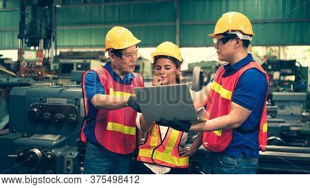 Scene Of Inspectors Team Asking Information With Woman Worker And Checking The Safety And Review The