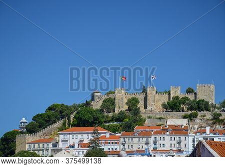 View Of Old Town And Sao Jorge Castle From Sao Pedro De Alcantara Viewpoint (miradouro), In Lisbon,