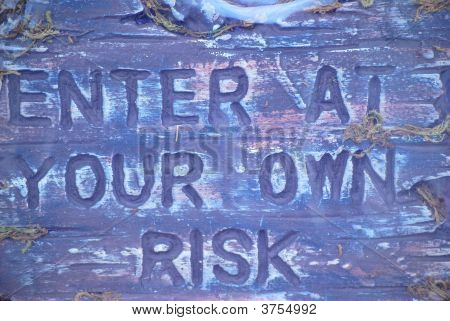 Enter At Your Own Risk Sign.