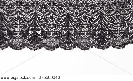 Black Lace Texture With Flowers On A White Background. Background Of Black Lace With A Flower Patter