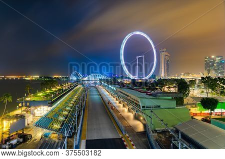 Singapore - 9 Sep 2019: Composite Image Of The Marina Bay Street Circuit Pit Building At Night, With