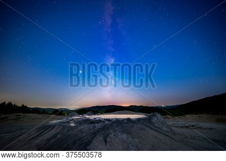 Milky Way Starry Sky Fading Away Into Morning Light With A Muddy Volcano In The Foreground Shot In R