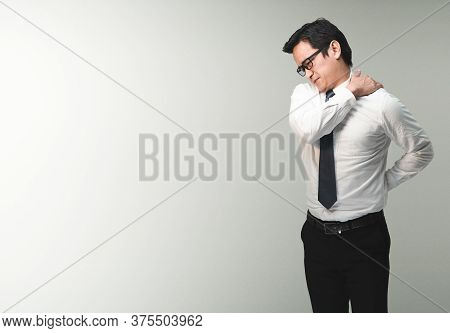 Exhausted Asian Office Worker Rubs His Shoulder Due To The Back And Shoulder Aches Shows Pain Expres