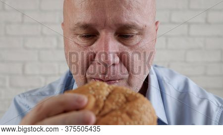 Starved Person Eating A Tasty Hamburger, Enjoy A Delicious Snack In A Fast Food Restaurant