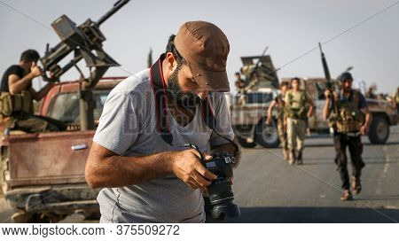 A Photo Of A War Photographer Depicting Armed Conflict