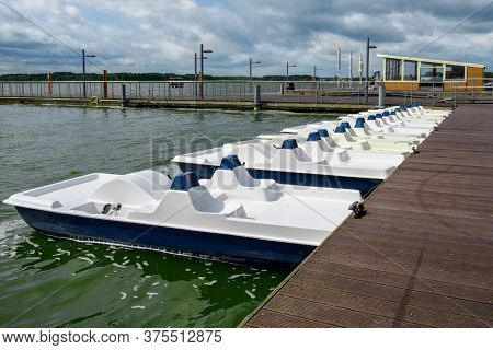 Pedal Boats Locked At Lake Marina. Pedal Boats For Rental.