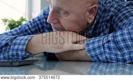Sad Elderly Person Isolated In Quarantine At Home Looking Bored And Disappointed To A Cell Phone