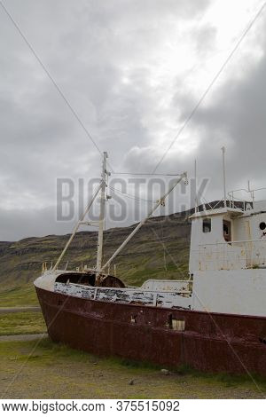 An Out-of-the-way Whaling Ship That Rusts On The Road To Látrabjarg On A Dead Cloudy Day. The Shipwr