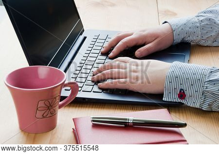 Place Of Work. Woman's Hands Typing On Laptop Keyboard