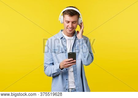 Lifestyle, Summer Holidays, Technology Concept. Handsome Modern Young Man In Casual Outfit, Listenin