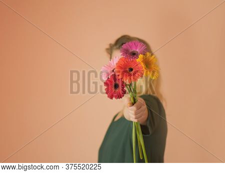 Woman With Gerberas Flowers Bouquet