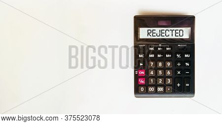 Black Calculator With Text Rejected On The White Background
