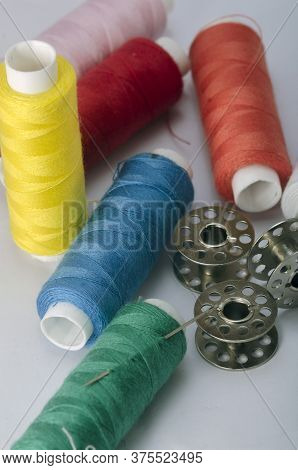 Sewing Tools Collection. Thread, Sewing Needle, Bobbins, In A White Background.