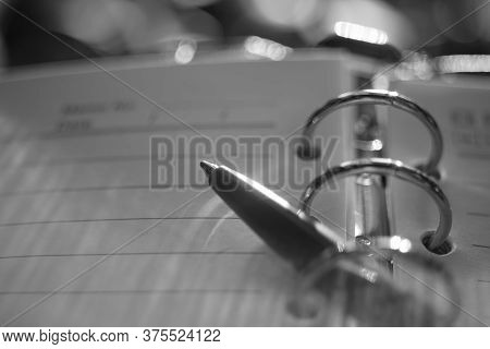 Ball Pen In Notebook. Macro Photo, Side View. Bw Photo