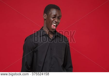 Cheerful Young African American Man Guy In Classic Black Shirt Posing Isolated On Bright Red Wall Ba
