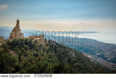 Our Lady Of Lebanon Maronite Church Sits On A Hill Over The Jounieh Bay, With Beirut Capital City In