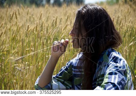 Sensual Woman Profile With Spikelet. Girl Relax And Think In Field. Daydreaming Concept. Sexy Woman
