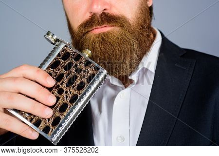 Hipster In Suit Hold Metal Flask For Alcohol. Alcohol Drink Concept. Man Drink Whiskey From Bottle.