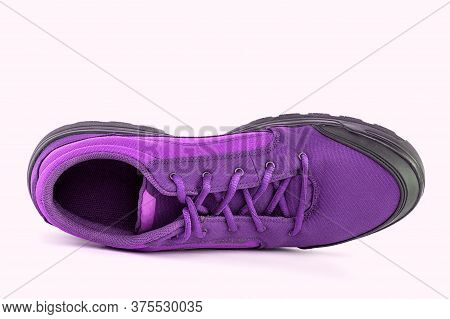 Right Cheap Purple Hiking Or Hunting Shoe Isolated On White Background - View From Above