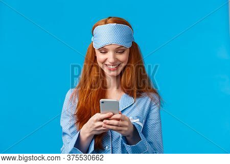 Mobile Addication, Technology And Beauty Concept. Cheerful Girl Waking Up And Grab Phone, Checking M