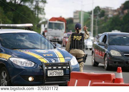 Salvador, Bahia / Brazil - January 6, 2015: Federal Highway Police (prf) Agent Is Seen Alongside The