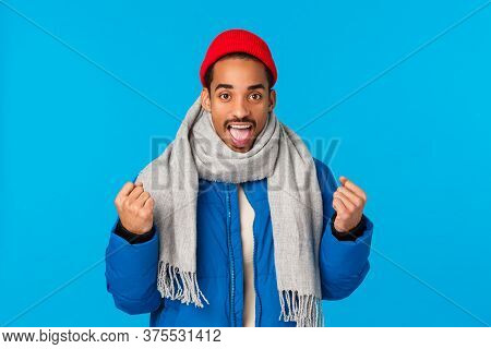 Yeah We Can Do It. Encouraged And Motivated Good-looking Cheerful African American Man In Padded Jac