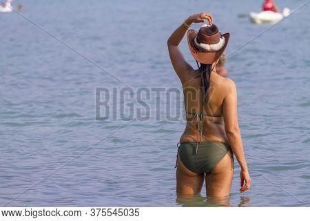 Woman With Swimsuit Stand Looking At Beach Koh Chang Thailand. Koh Chang Is Located In The Eastern G