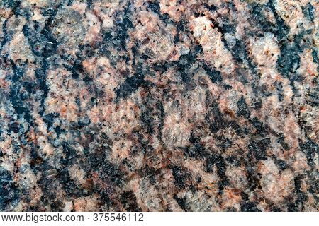 Natural Stone Granite Background Or Stone Texture For Design. View From Above