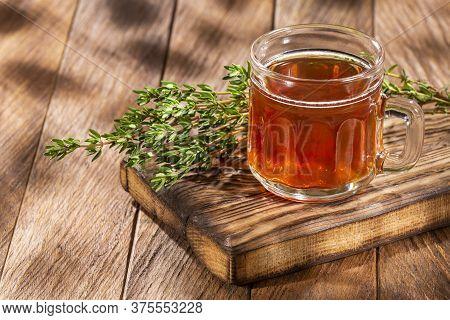 Fresh And Organic Thyme Tea - Thymus. Wood Background