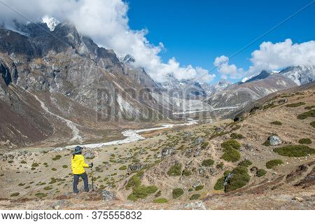 Trekker Looking To The Beautiful Valley During Trekking From Dingboche Village To Lobuche Village In