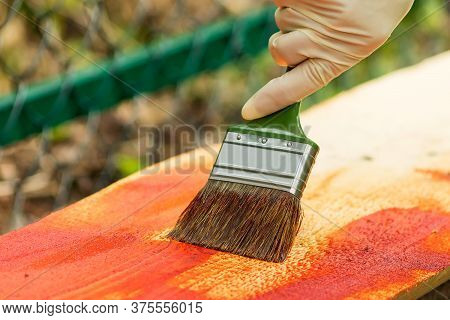 Antiseptic Coating Of A Wooden Board With A Brush In The Fresh Air.
