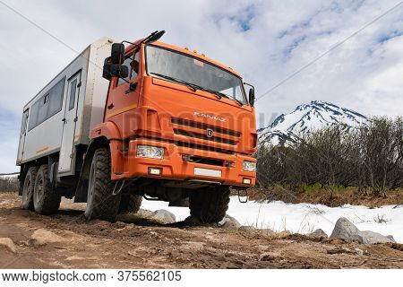 Russian Off-road Passenger Expedition Truck Kamaz On Mountain Road In Direction Popular Travel Desti