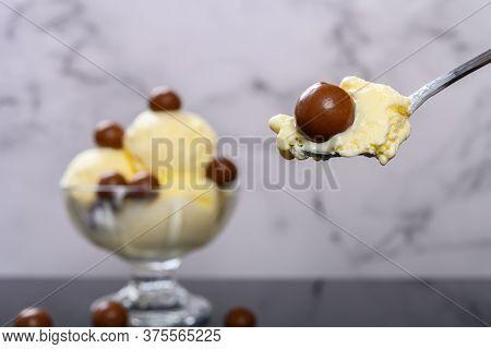 Eating Bowl Of Vanilla Flavor Ice Cream Sundae With Chocolate Candy