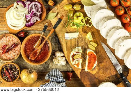 Homemade Preparation Of Pickled Cheese With Chili Peppers. Pickled Cheese With Herbs, Olives. Camemb