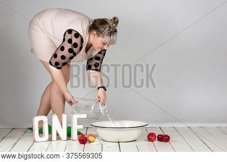 A One-year-old Boy Or Girl Will Participate In The Photoset. Woman Prepares Background For The Photo