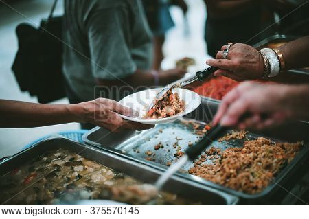 Feeding To The Poor To Hands Of A Beggar : Concept Of Feeding Food For Beggar