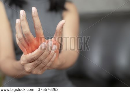 Woman With Pain In His Hand Because Of Hard Work, Ache In Human Body , Office Syndrome,bone And Join