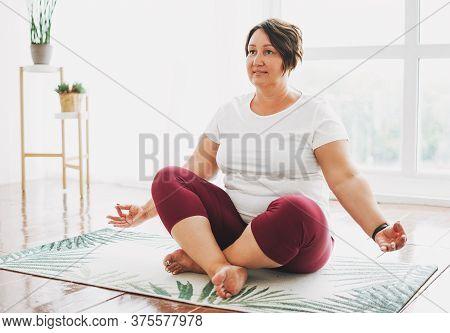 Adult Charming Brunette Woman Plus Size Body Positive Practice Yoga At Bright Studio