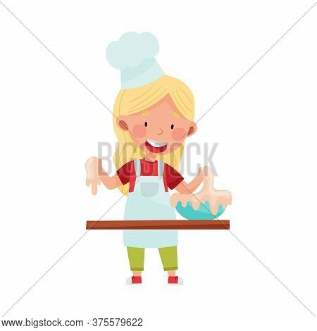 Little Girl Character In Hat And Apron Standing At Kitchen Table And Kneading Dough Vector Illustrat
