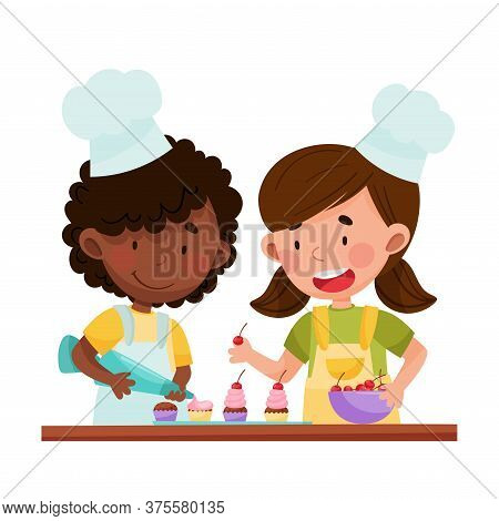 Happy Girl Chef Characters Wearing Apron And Hat Decorating Cupcakes With Cherry And Whipped Cream V