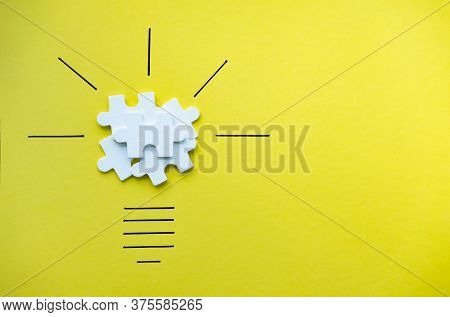 Light Bulb Over Yellow Background In Vision And Idea Conceptual Image. Conceptual Image Of Creativit