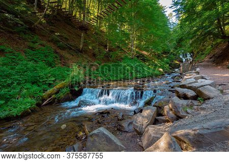 Mountain River In The Forest. Fresh Water Stream From Waterfall. Beautiful Nature Background. Wonder