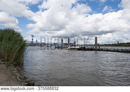 Temse, Belgium, 05 July 2020, Turbulent Water Of The Scheldt With The Last Crane Van Boelwerf In The