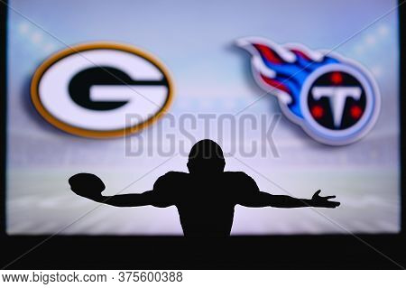 Green Bay Packers Vs. Tennessee Titans. Nfl Game. American Football League Match. Silhouette Of Prof