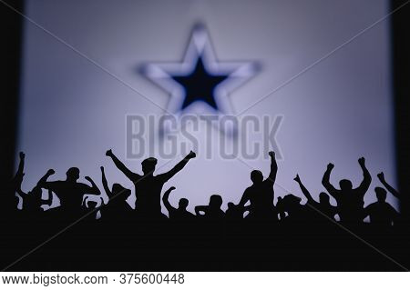 Dallas Cowboys. Fans Support Professional Team Of American National Foorball League. Silhouette Of S